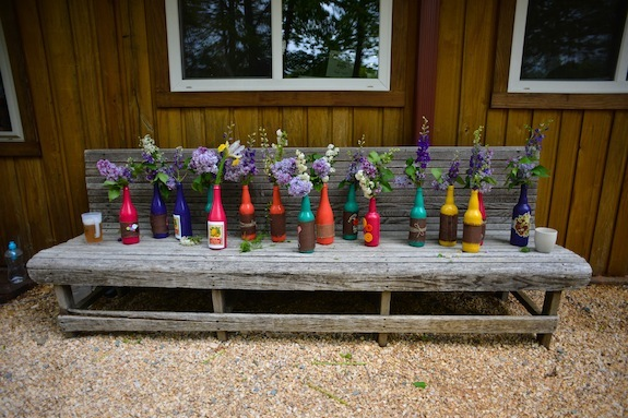 DIY spray painted bright color bottles wedding decorations