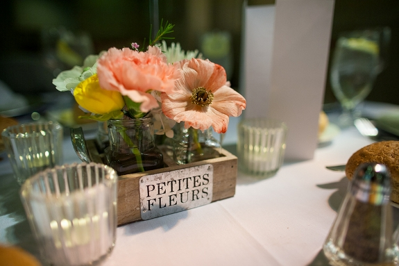 flowers in wine boxes wedding centerpieces
