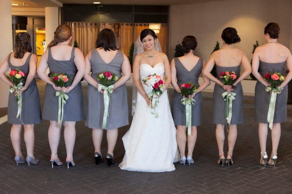 grey bridesmaids green bouquets