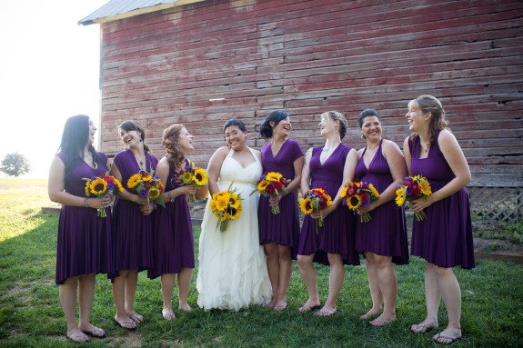 purple bridesmaids dresses sunflower bouqets