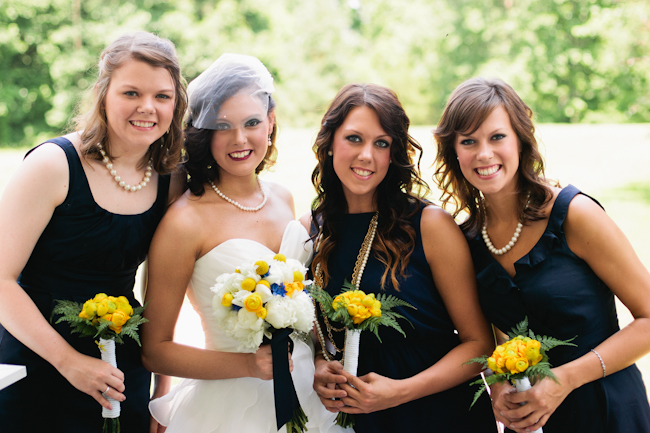 navy bridesmaids yellow bouquets