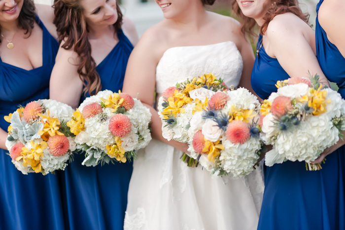 bright blue bridesmaids neutral bouquets