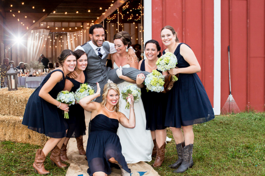 bridesmaids in navy blue and cowboy boots