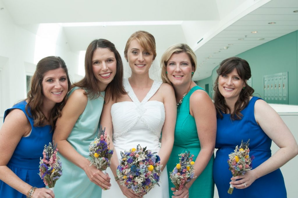 mismatched blue teal bridesmaids dresses